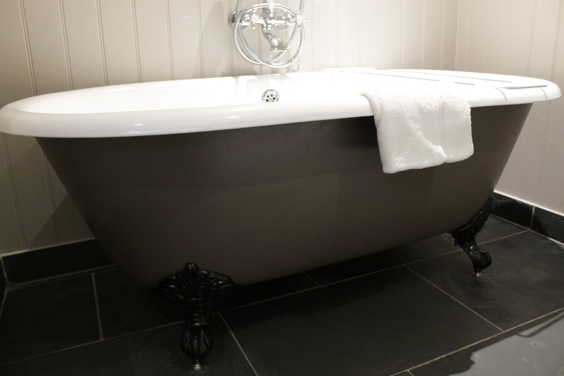 Roll-top bath at Tudor Farmhouse Hotel Gloucestershire