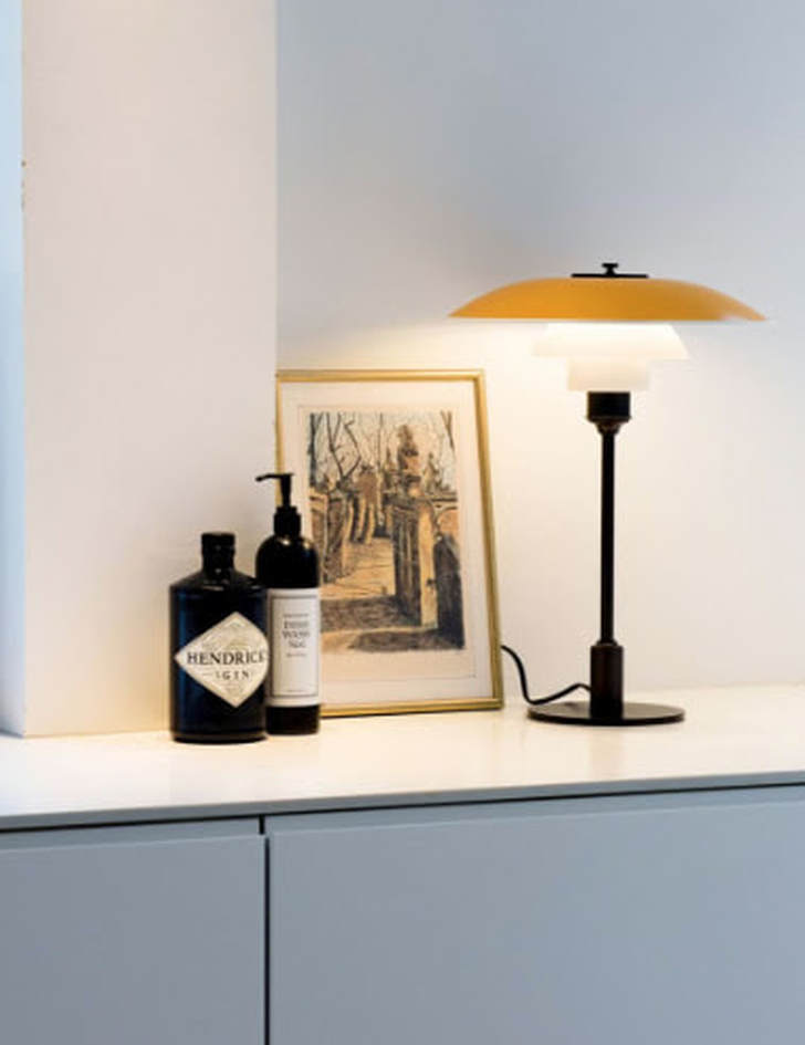 yellow home interiors yellow table lamp by Louis Poulsen